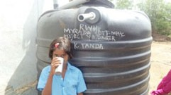 Thippana's daughter drinking water from the Rain Water harvesting system:  July 30, 2014
