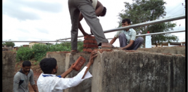 Labourers fixing of GI sheet - July 26, 2014